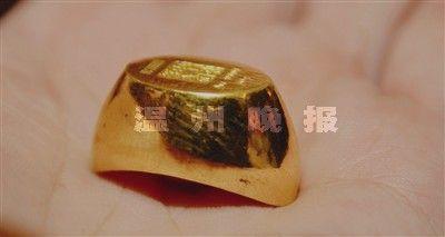 中国黄金9999金元宝。(图片来源:温州网)
